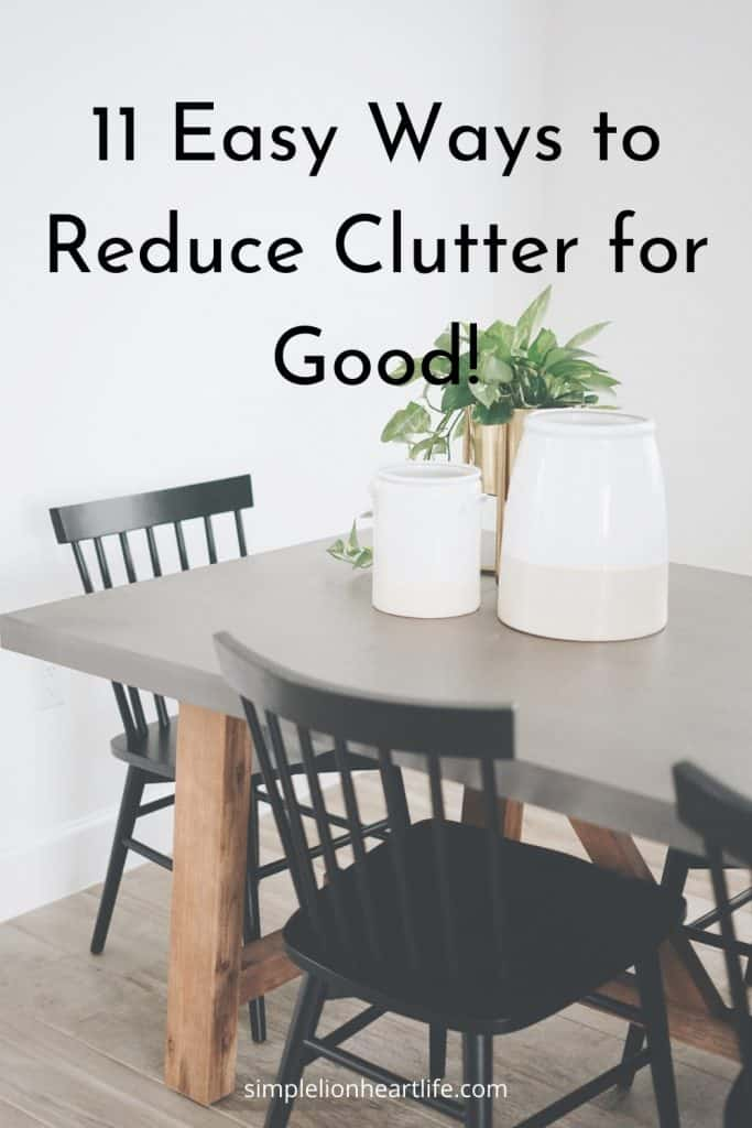Post title graphic: 11 Easy Ways to Reduce Clutter for Good! [Dining table with black chairs and 3 pitchers with plants on the table]