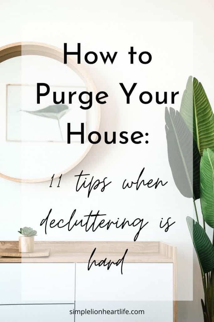 (wood topped dresser with round mirror on wall and tropical plant) title graphic: How to Purge Your House - 11 tips when decluttering is hard